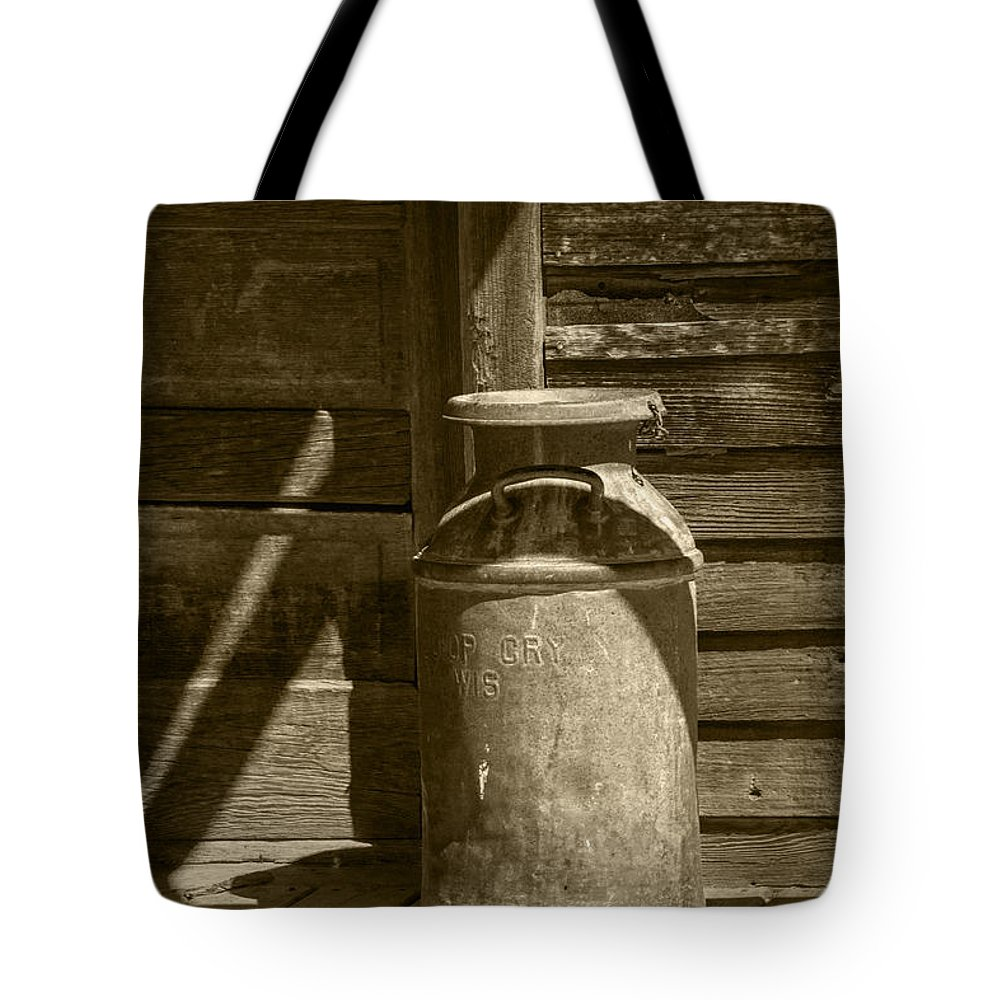 Creamery Can Tote Bag featuring the photograph Sepia Photograph Of Vintage Creamery Can By The Old Homestead In 1880 Town by Randall Nyhof
