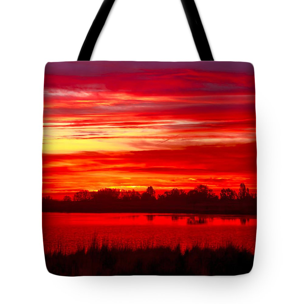 Sunset Tote Bag featuring the photograph Shades Of Red by Robert Bales