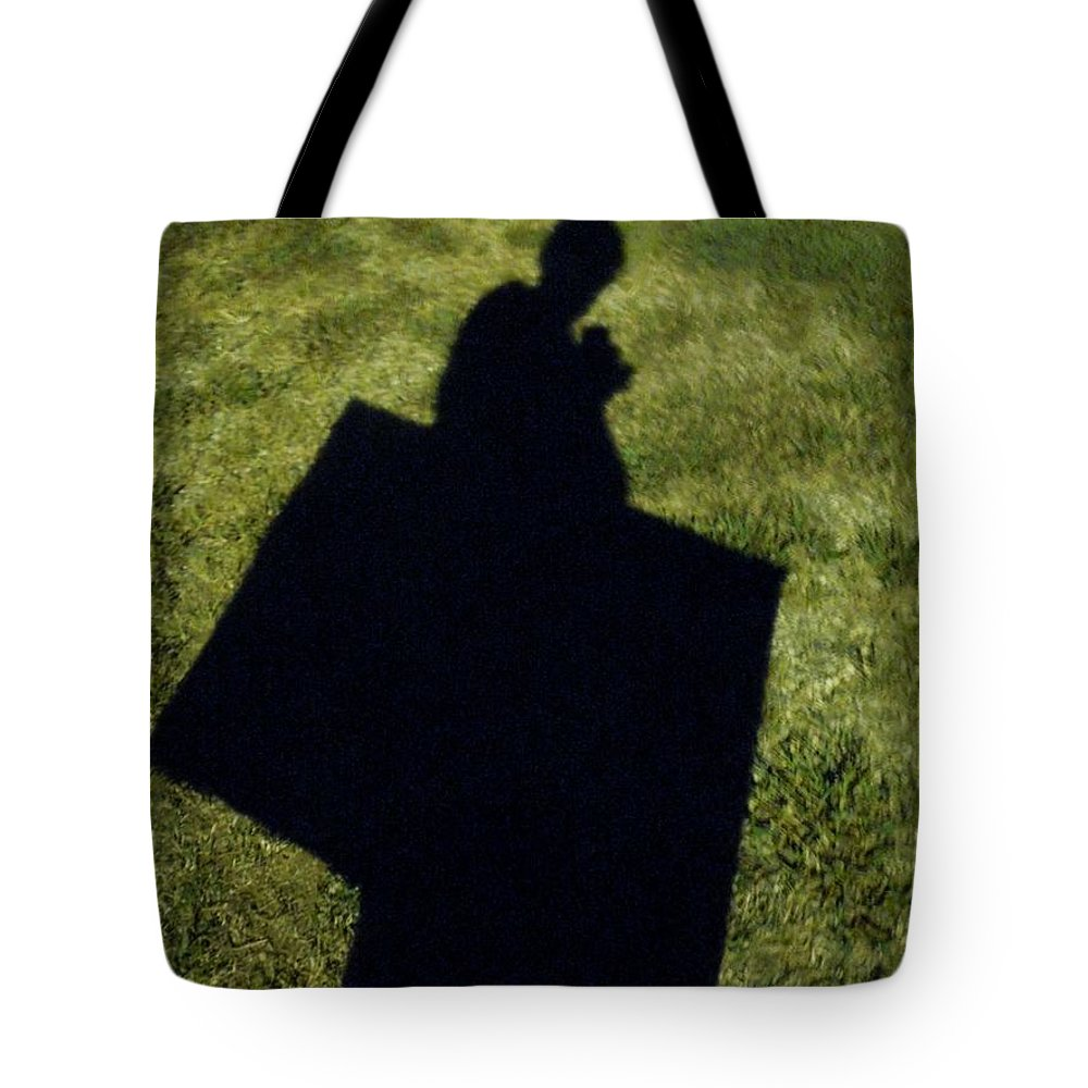Shadow Tote Bag featuring the photograph Shadow Carrying Art Portfolio And Drinking A Soda by Renee Trenholm