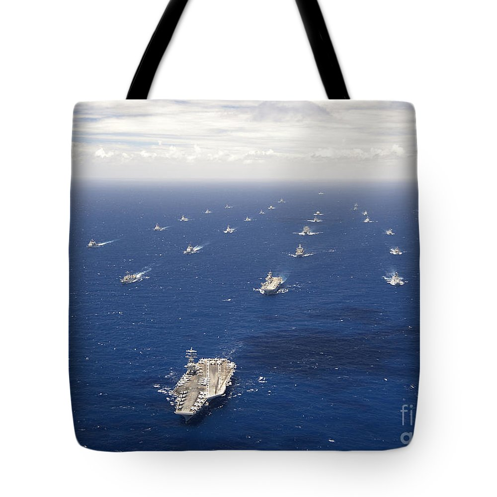 Rimpac Tote Bag featuring the photograph Ships And Submarines Participating by Stocktrek Images
