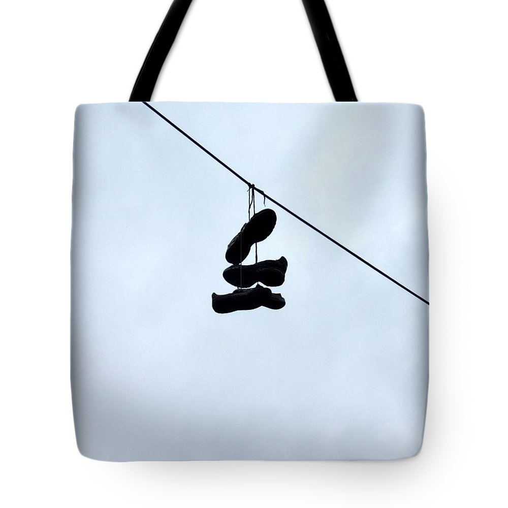 Shoes Tote Bag featuring the photograph Shoes On The Line by Marc Philippe Joly