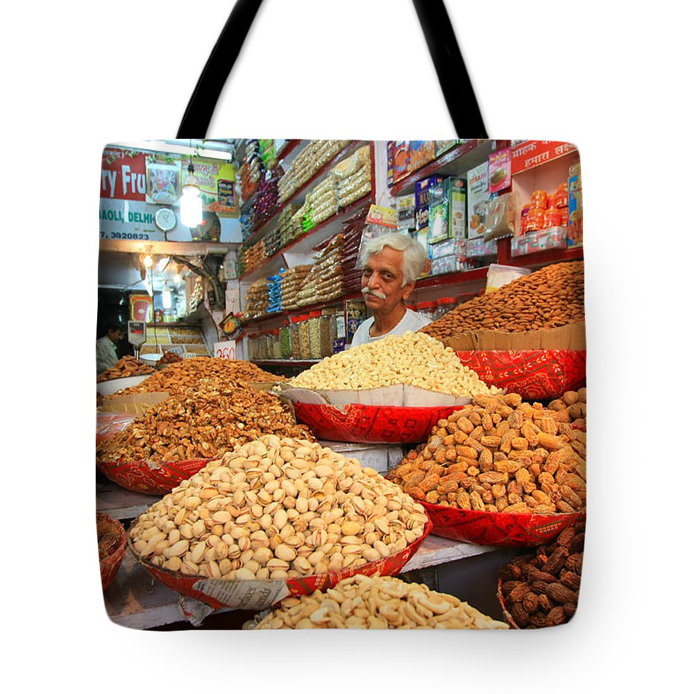 India Tote Bag featuring the photograph Shop Keeper Chanderi India by Amanda Stadther