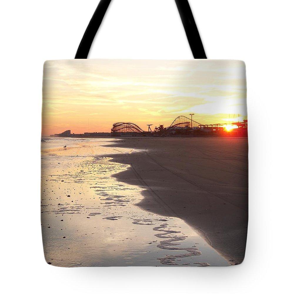 Shoreline Tote Bag featuring the photograph Shoreline Sunset by Eric Schiabor