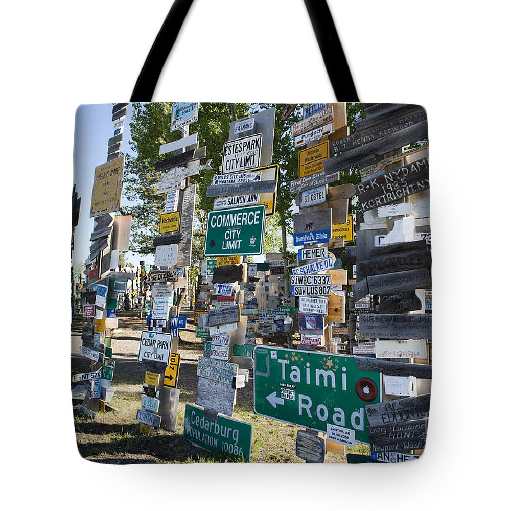 Sign Tote Bag featuring the photograph Sign Forest Watson Lake by David Arment