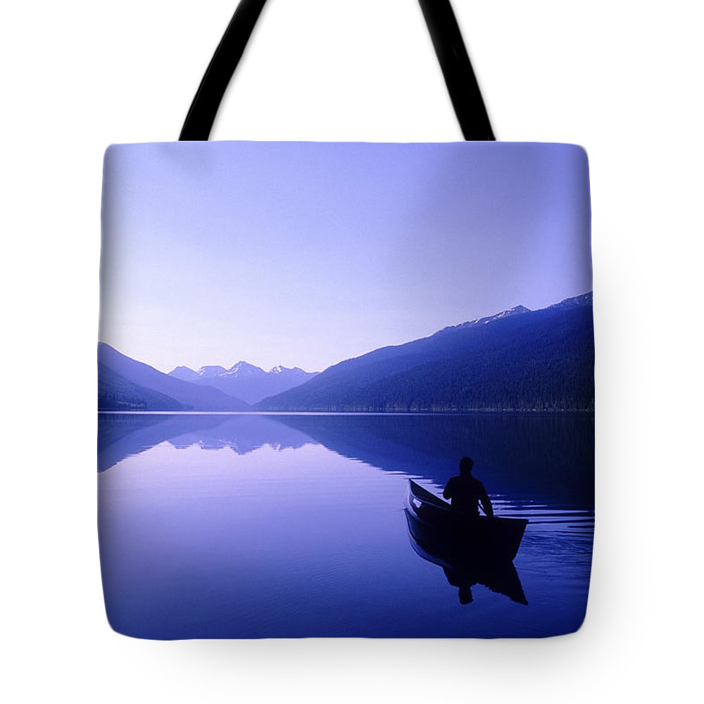 Light Tote Bag featuring the photograph Silhouette Of A Canoeist At Sunrise by Josh McCulloch