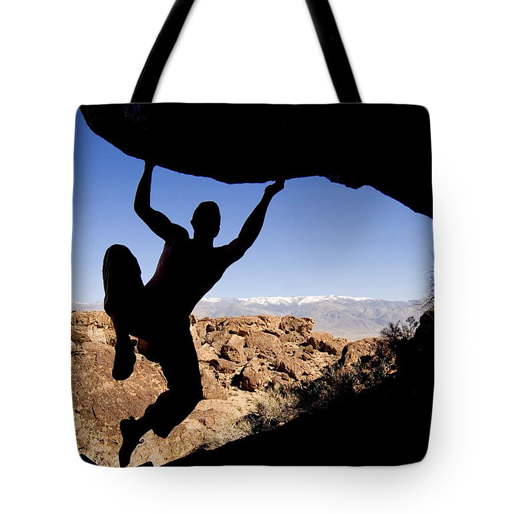 Light Tote Bag featuring the photograph Silhouette Of A Rock Climber by Josh McCulloch