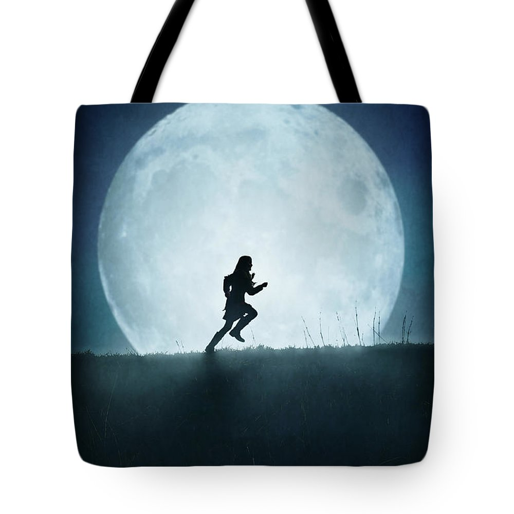 Girl Tote Bag featuring the photograph Silhouette Of Girl Running Against Full Moon by Lee Avison