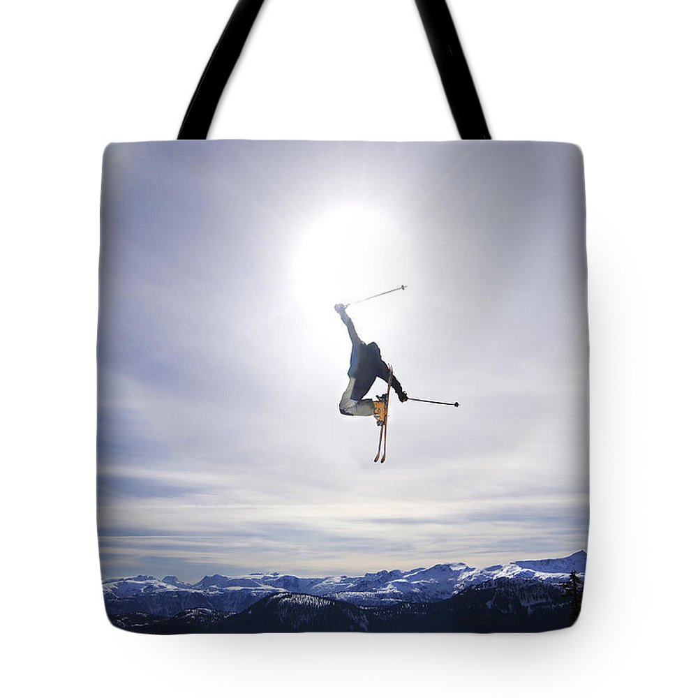 Light Tote Bag featuring the photograph Skier Jumping, Courtenay, Bc by Josh McCulloch
