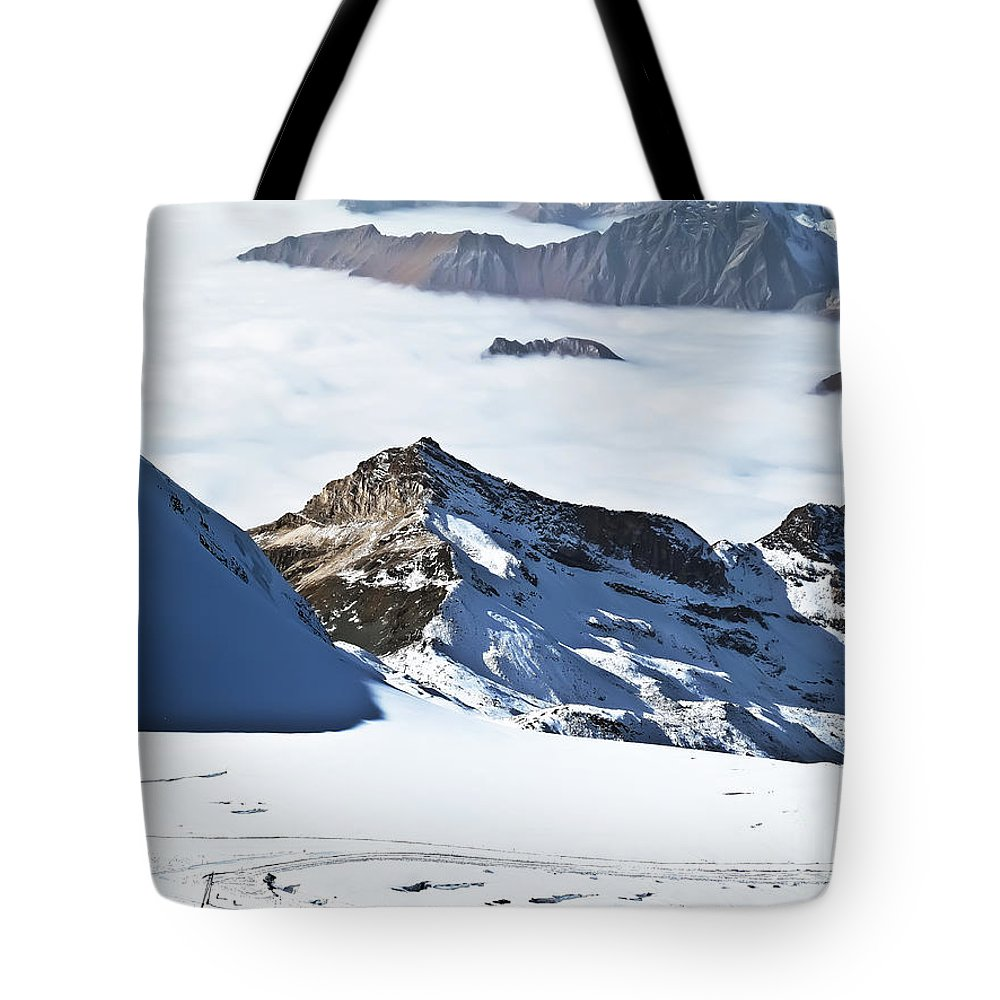 Travel Tote Bag featuring the photograph Skiing Down A Storm by Elvis Vaughn