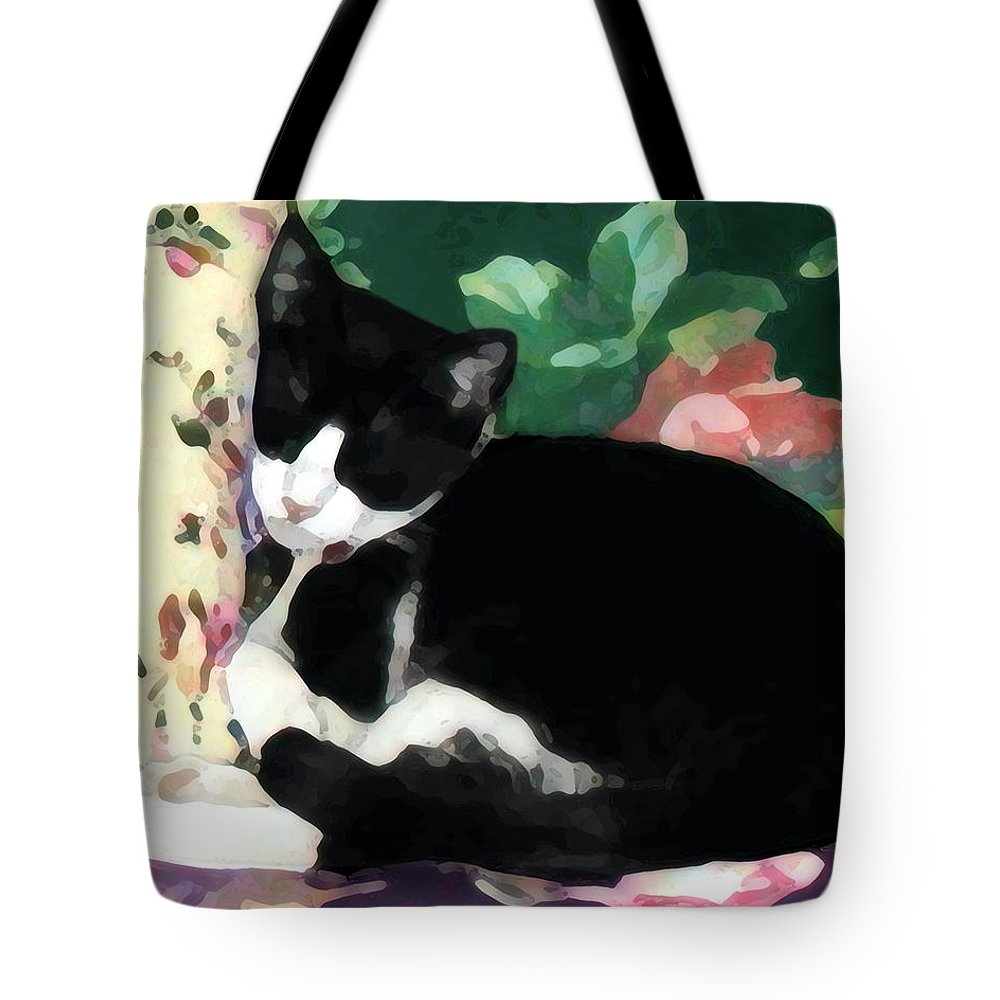 Black And White Tote Bag featuring the photograph Sleeping Kitty by Jeanne A Martin