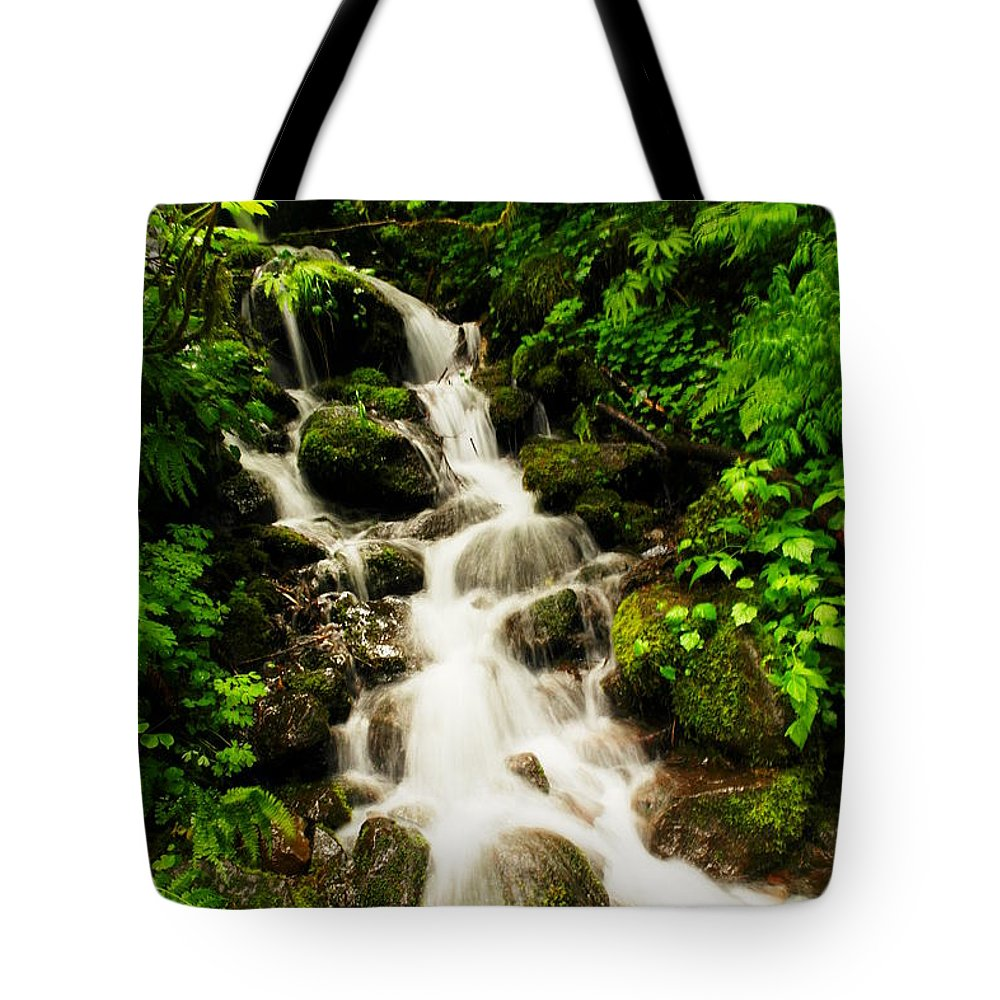 Rivers Tote Bag featuring the photograph Sliding Over The Rocks by Jeff Swan