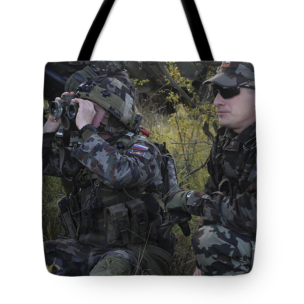Military Tote Bag featuring the photograph Slovenian Soldiers Watch For Simulated by Stocktrek Images