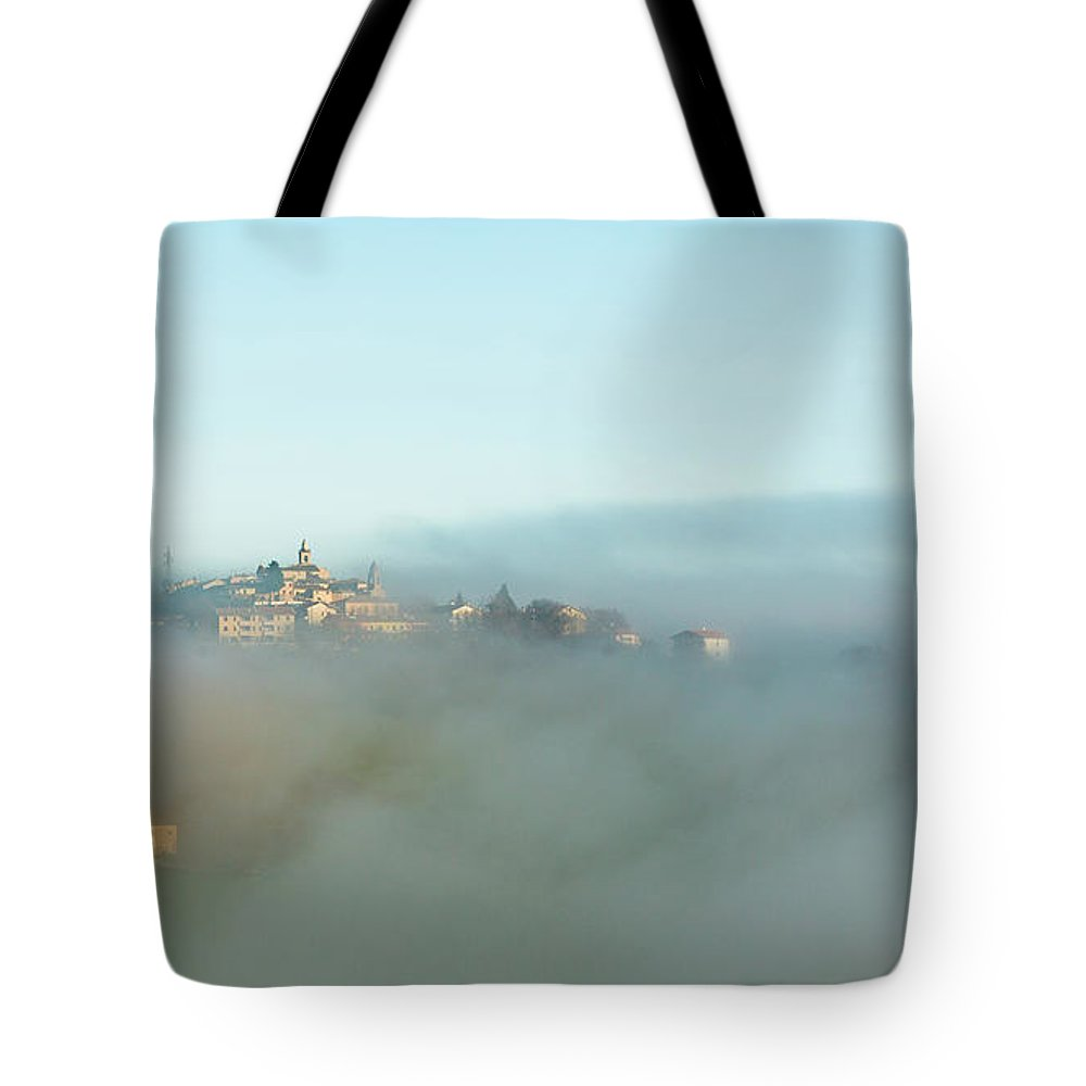 Scenics Tote Bag featuring the photograph Small Italian Village In The Fog by Deimagine