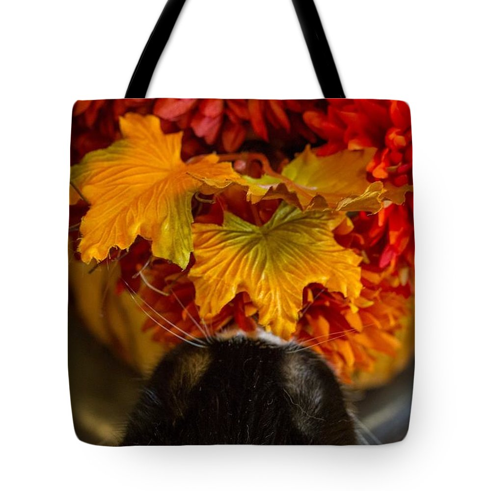 Animals Tote Bag featuring the photograph Smelling The Roses Or Something Like That by Kathleen Odenthal