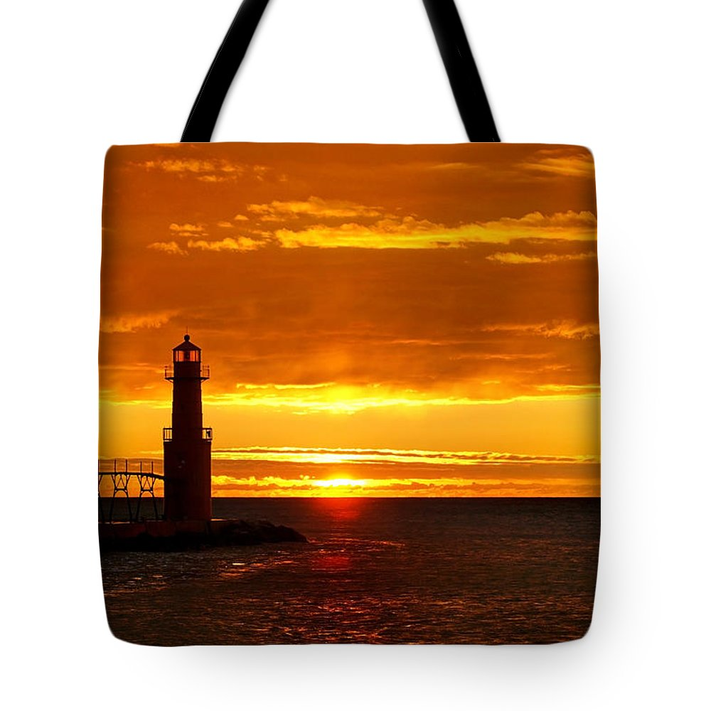 Lighthouse Tote Bag featuring the photograph Smoldering Sunrise by Bill Pevlor