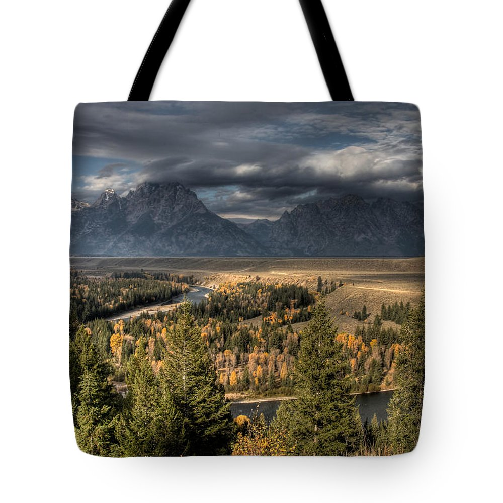 Snake River Storm Tote Bag featuring the photograph Snake River Storm by Wes and Dotty Weber