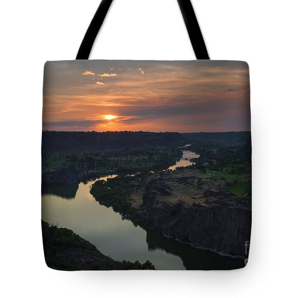 Snake River Tote Bag featuring the photograph Snake River Sunset by Mike Dawson