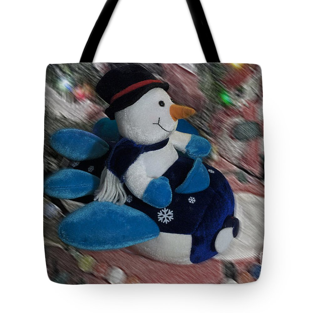 Snowmen Tote Bag featuring the photograph Snowman And His Speeding Plane by Thomas Woolworth