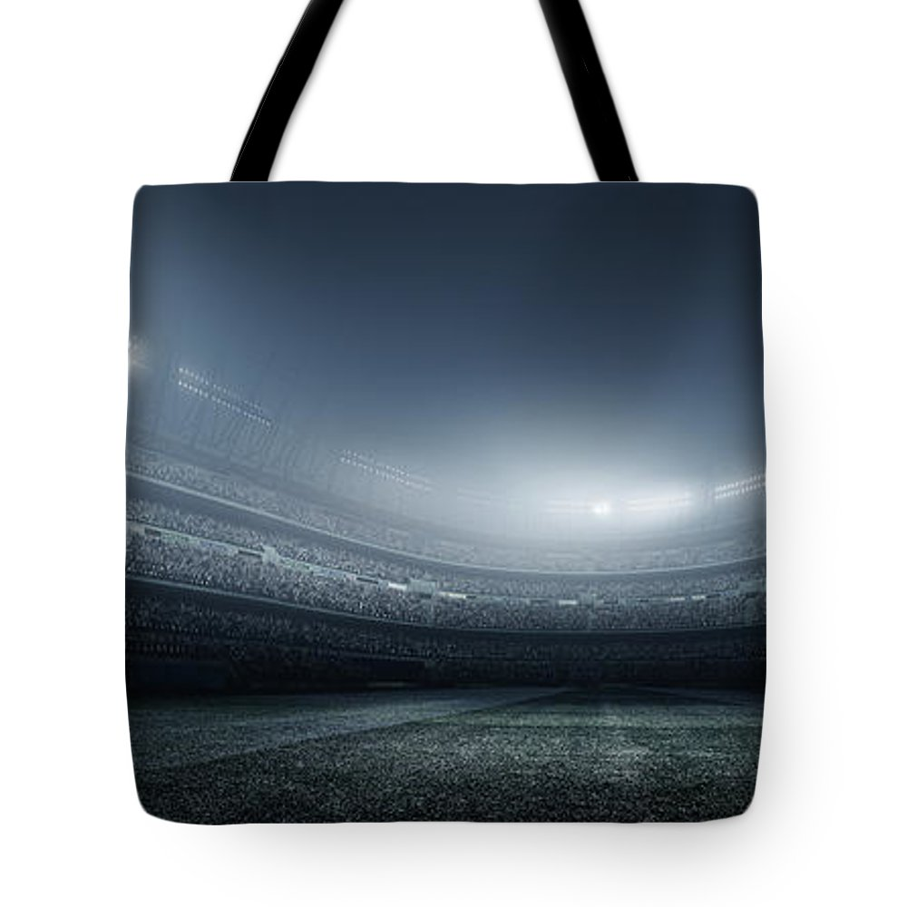 Soccer Uniform Tote Bag featuring the photograph Soccer Player With Ball In Stadium by Dmytro Aksonov