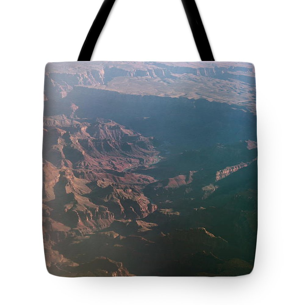 Rocky Tote Bag featuring the photograph Soft Early Morning Light Over The Grand Canyon by Kume Bryant