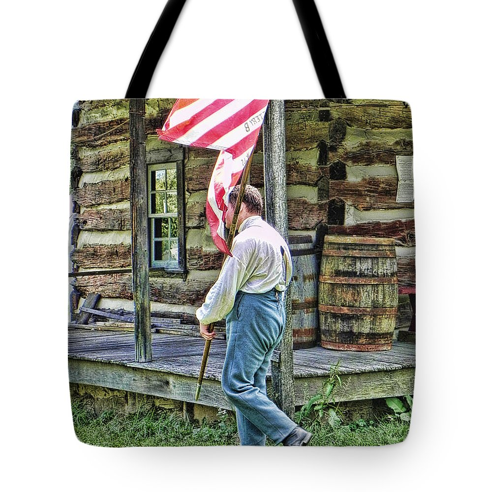 Soldier Tote Bag featuring the photograph Soldier At Bedford Village Pa by Kathy Churchman