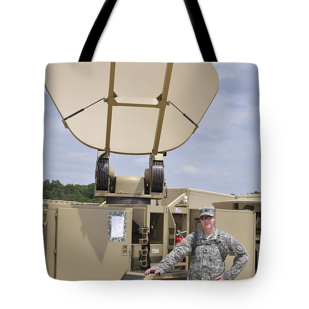 An/tsc-185 Tote Bag featuring the photograph Soldier Stands Next To A Satellite by Stocktrek Images