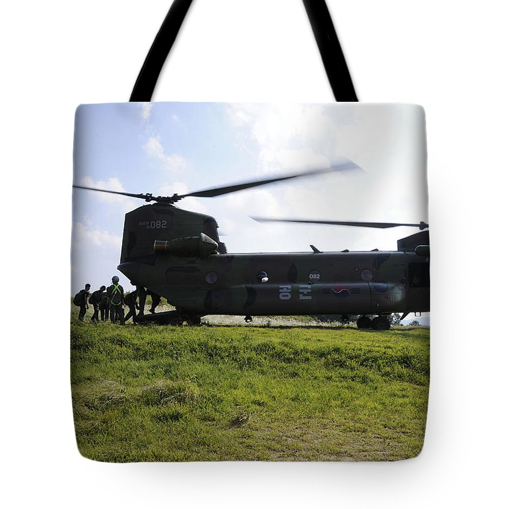 Helicopter Tote Bag featuring the photograph Soldiers Board A Republic Of Korea Air by Stocktrek Images