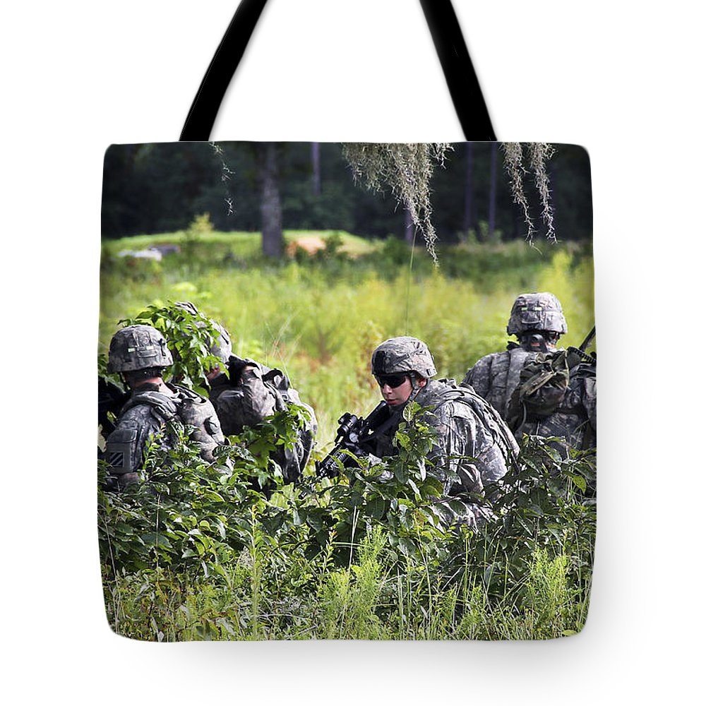 Military Tote Bag featuring the photograph Soldiers Maintain Security At Fort by Stocktrek Images