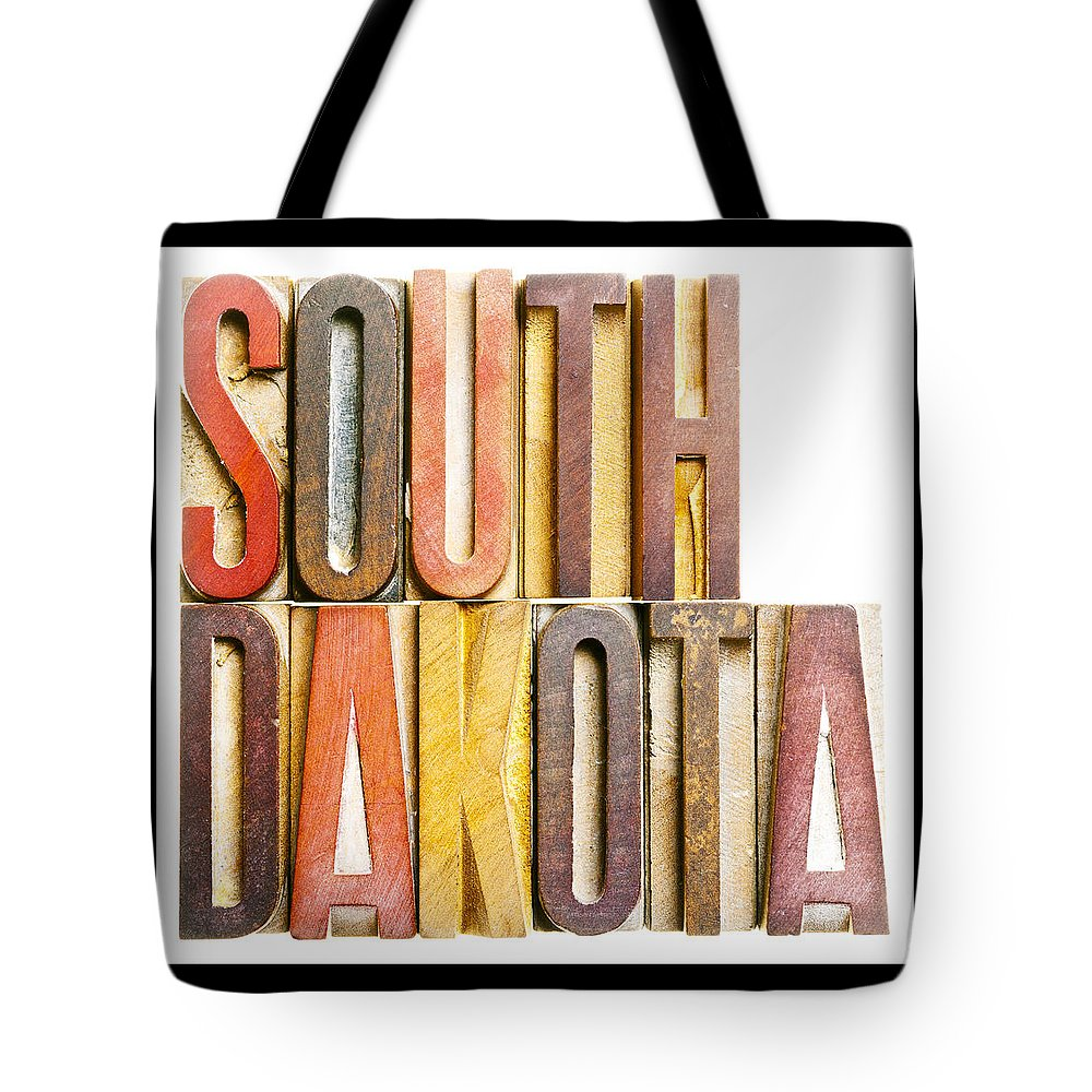 South Dakota Tote Bag featuring the photograph South Dakota Antique Letterpress Printing Blocks by Donald Erickson