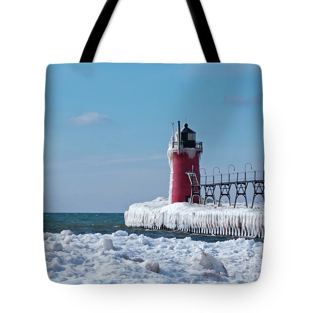 Lighthouse Tote Bag featuring the photograph South Haven Ice by Ann Horn