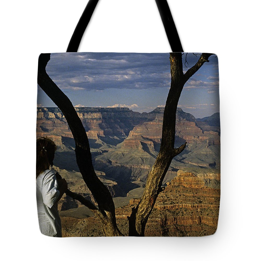 Grand Canyon National Park Tote Bag featuring the photograph South Rim Grand Canyon Sunset Light On Rock Formations With Woma by Jim Corwin