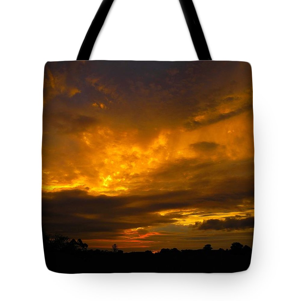 Sunset Tote Bag featuring the photograph Spacey Sunset by Mark Blauhoefer