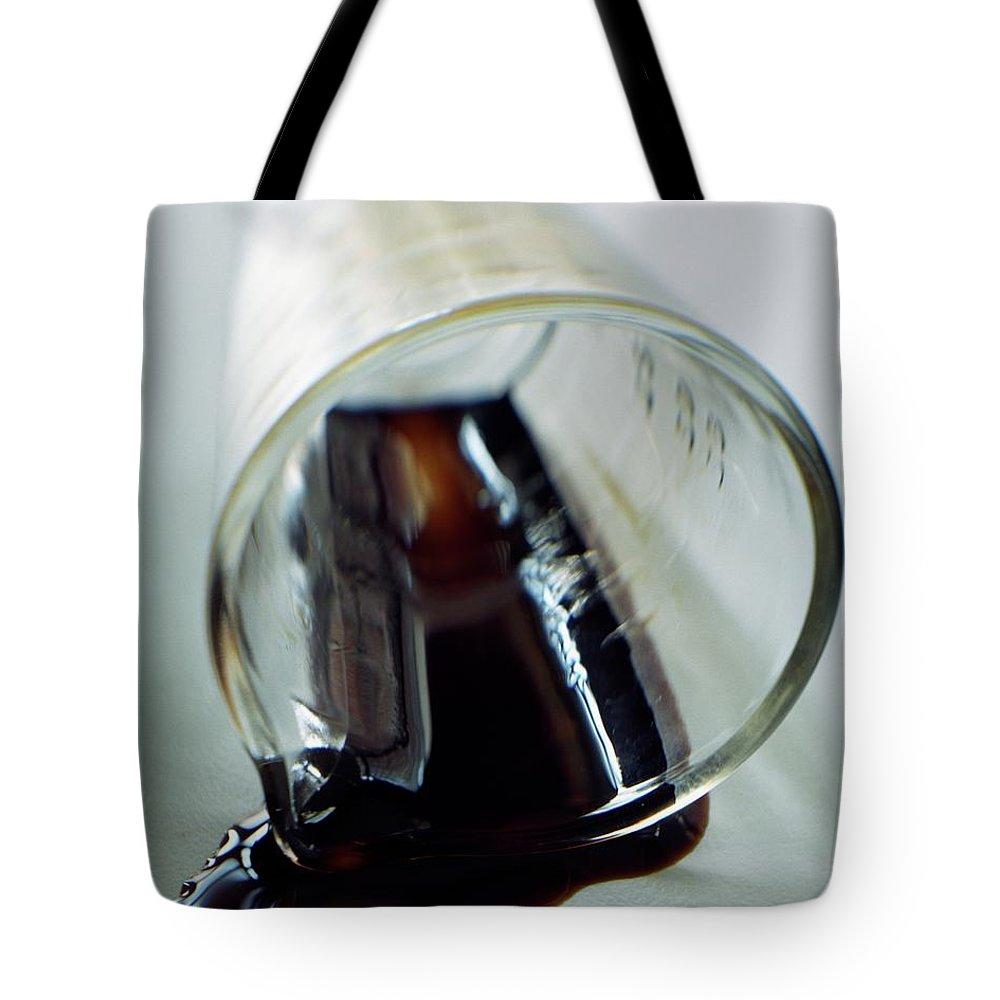 Food Tote Bag featuring the photograph Spilled Balsamic Vinegar by Romulo Yanes