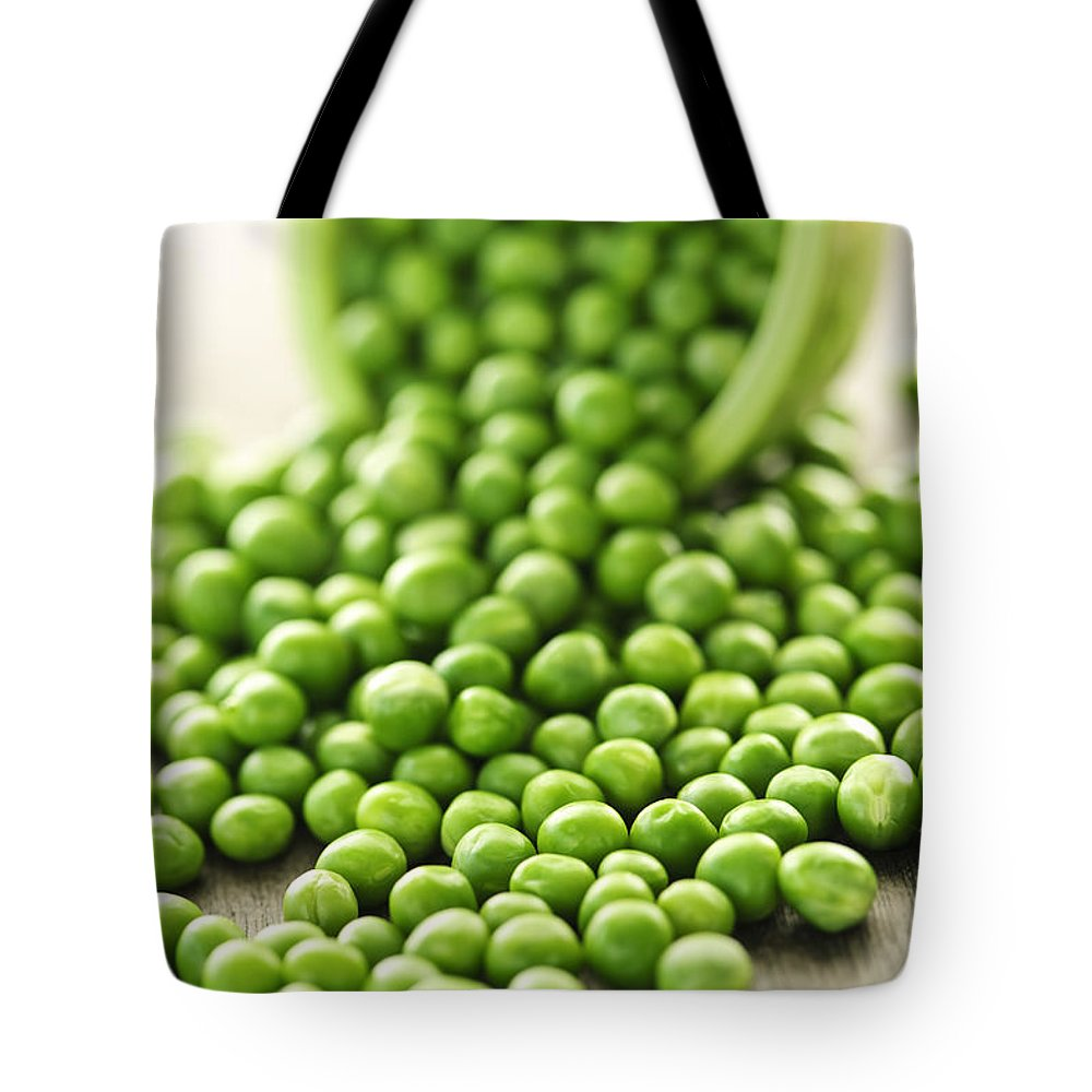 Peas Tote Bag featuring the photograph Spilled Bowl Of Green Peas by Elena Elisseeva