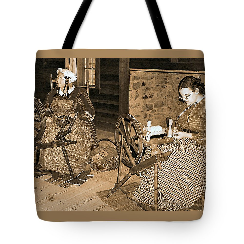 Spinning Tote Bag featuring the photograph Spinning Wheel by Nadine Lewis