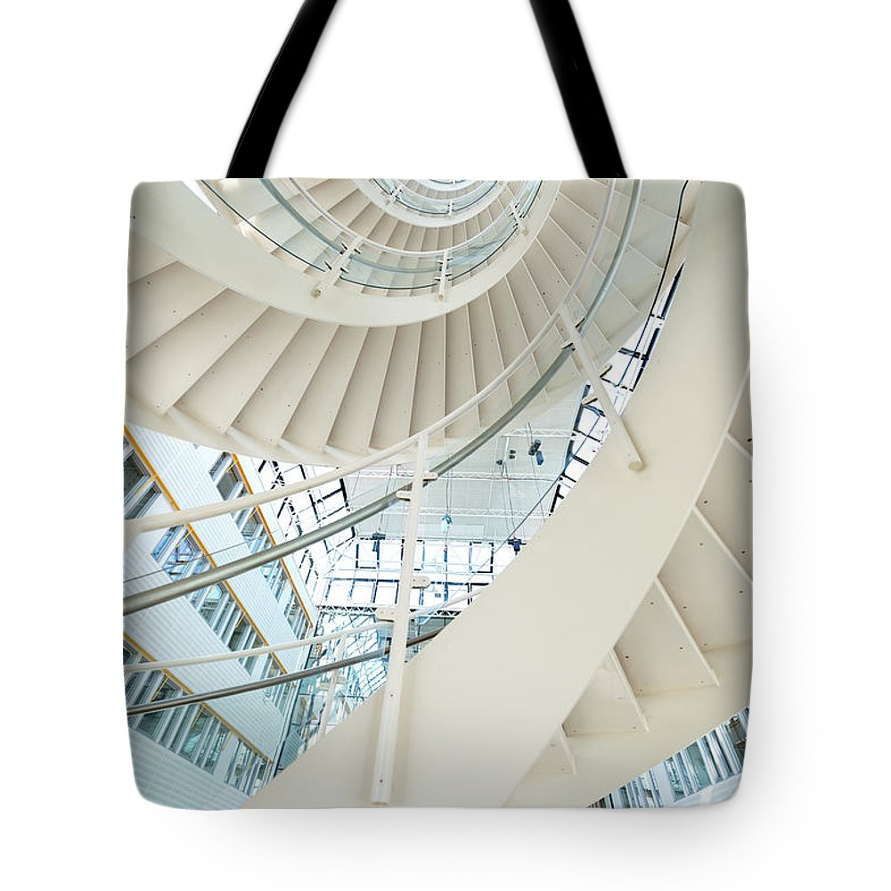 Steps Tote Bag featuring the photograph Spiral Staircase Inside Office Complex by Blurra