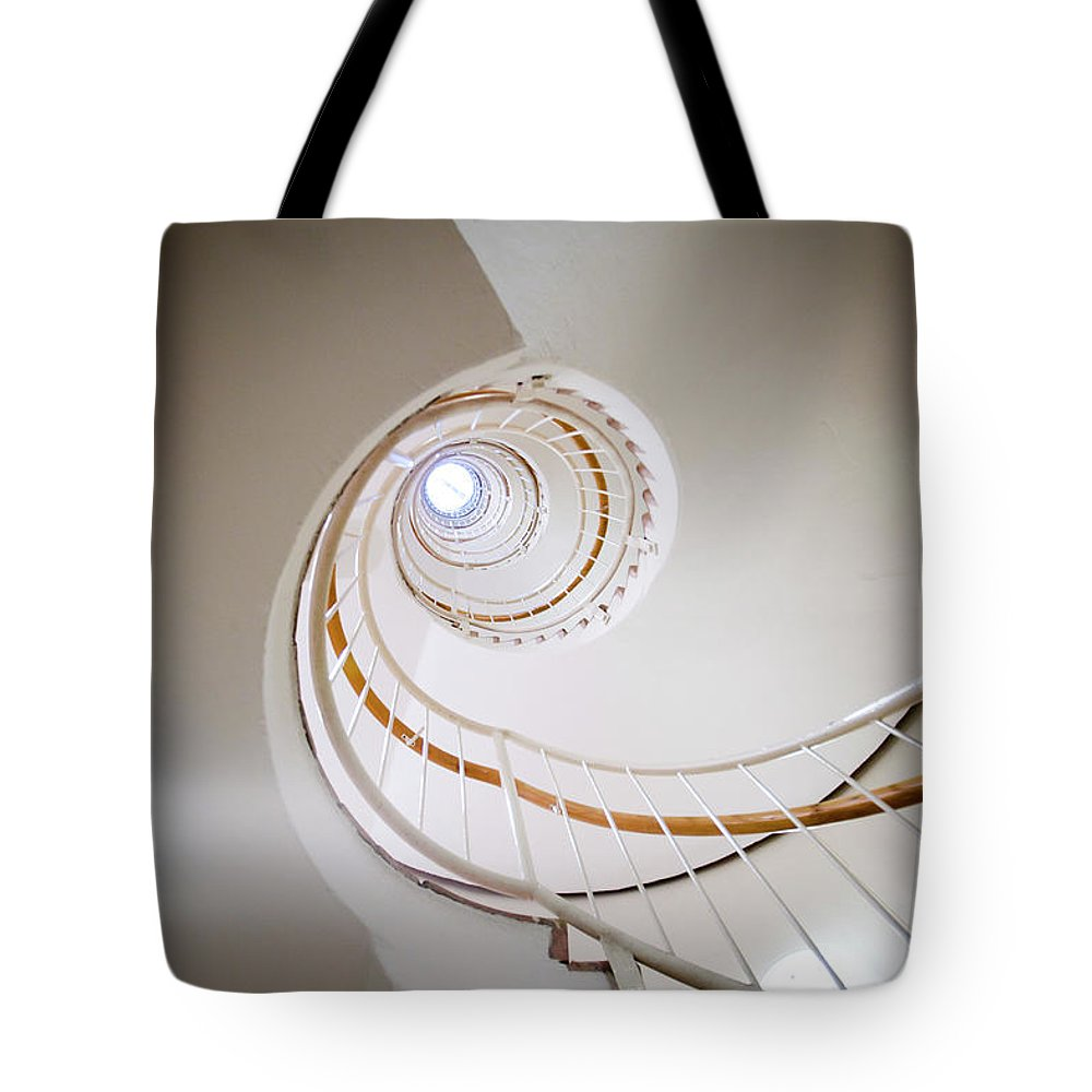 Apartment Tote Bag featuring the photograph Spiral Staircase by Johner Images