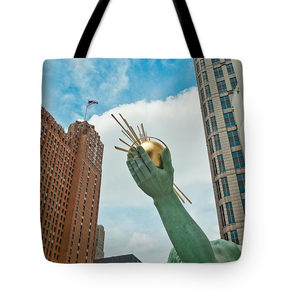 Detroit Tote Bag featuring the photograph Spirit Of Detroit's Left Hand by Steven Dunn