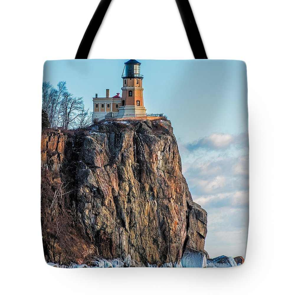 Split Rock Lighthouse Tote Bag featuring the photograph Split Rock Lighthouse In Winter by Paul Freidlund
