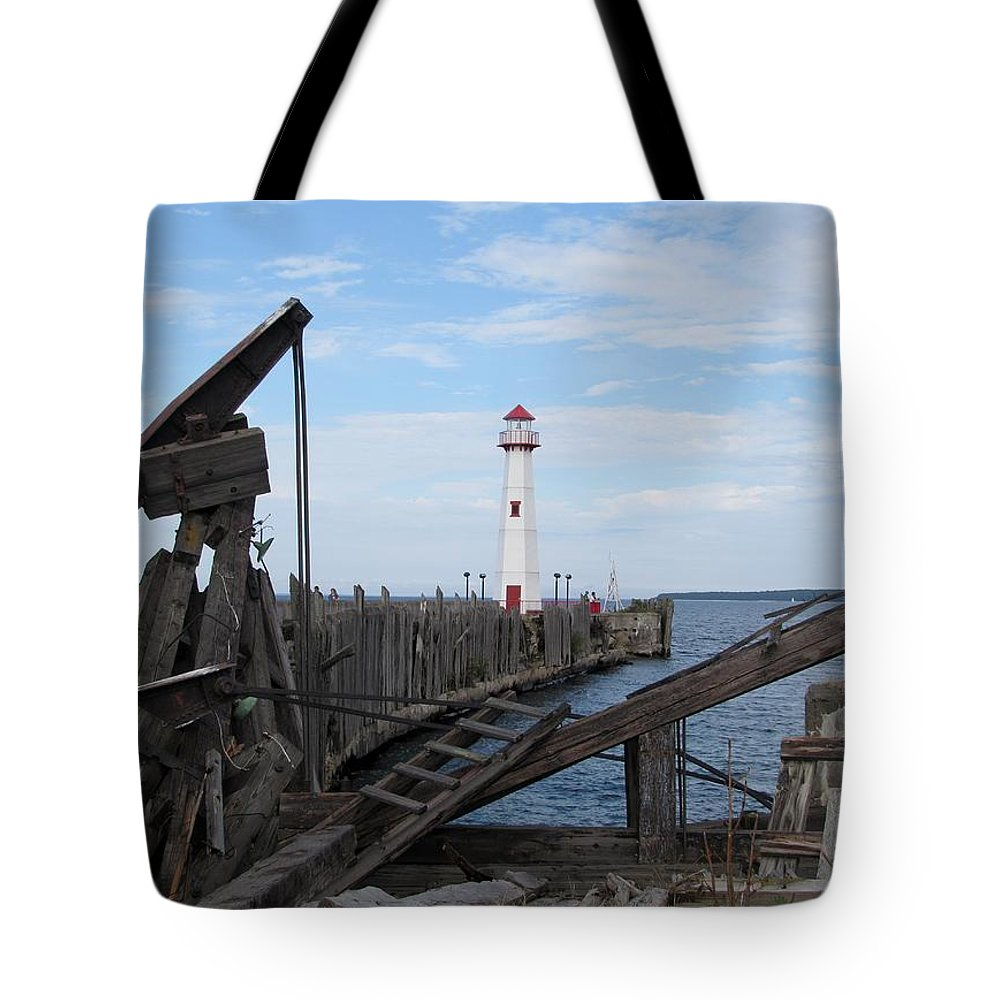 St. Ignace Tote Bag featuring the photograph St. Ignace Lighthouse by Keith Stokes