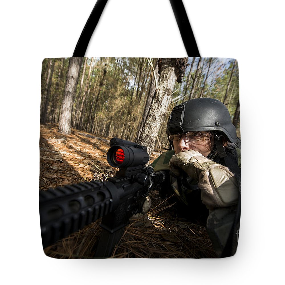 Military Tote Bag featuring the photograph Staff Sergeant Hydrates by Stocktrek Images