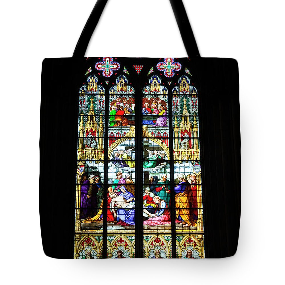 Gothic Style Tote Bag featuring the photograph Stained Glass Window In Cologne by Julian Elliott Photography
