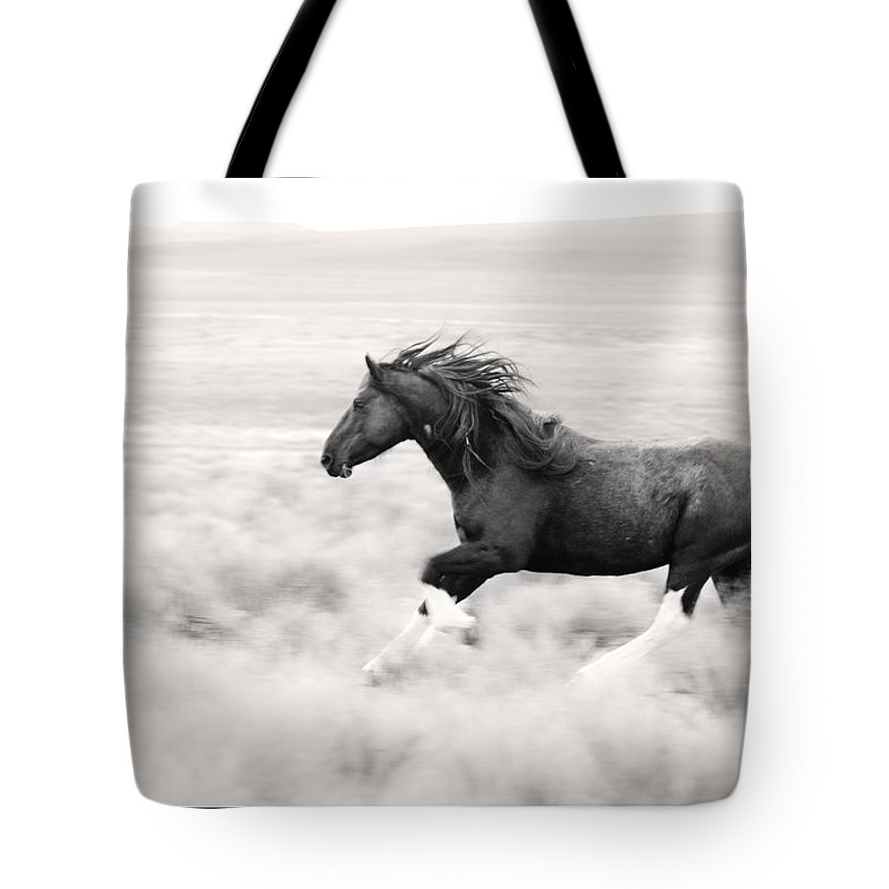 Stallion Blur Tote Bag featuring the photograph Stallion Blur by Wes and Dotty Weber