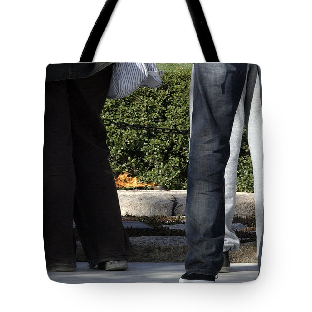 Eternal Flame Tote Bag featuring the photograph Standing Before The Eternal Flame by Cora Wandel
