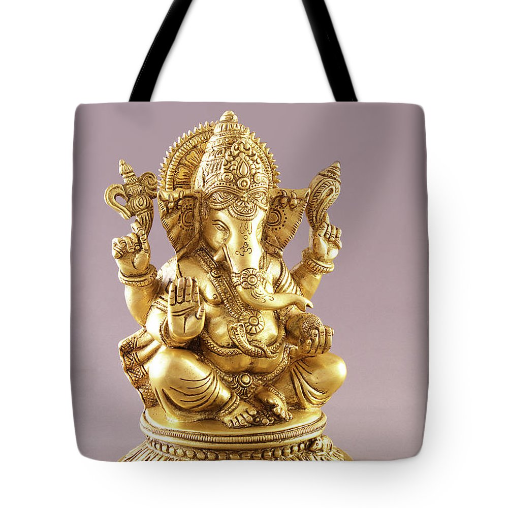 Spirituality Tote Bag featuring the photograph Statue Of Lord Ganesh by Visage