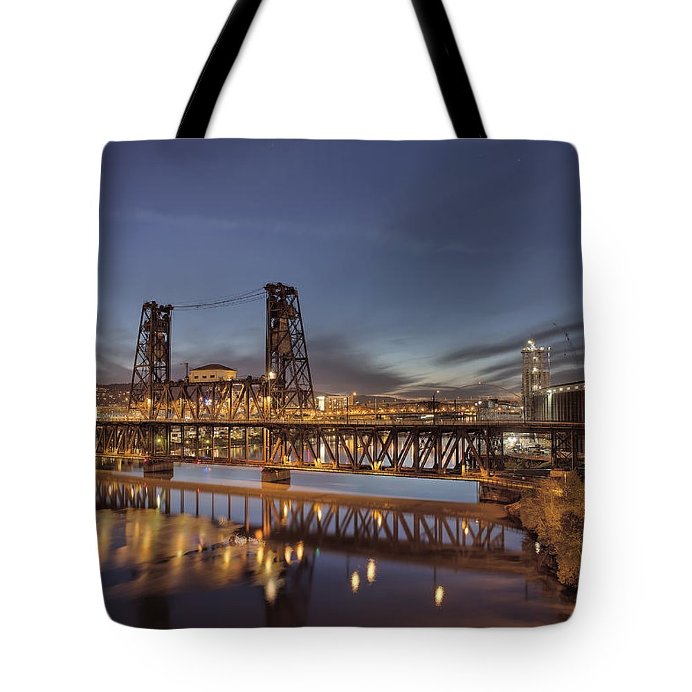 Steel Bridge Tote Bag featuring the photograph Steel Bridge Over Willamette River At Blue Hour by Jit Lim