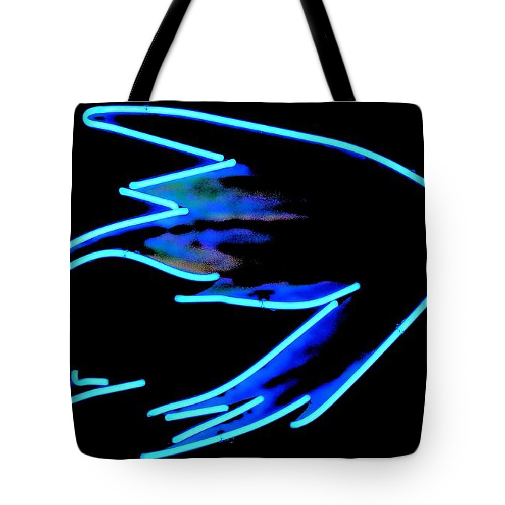 Newel Hunter Tote Bag featuring the photograph Steelhead Fly by Newel Hunter