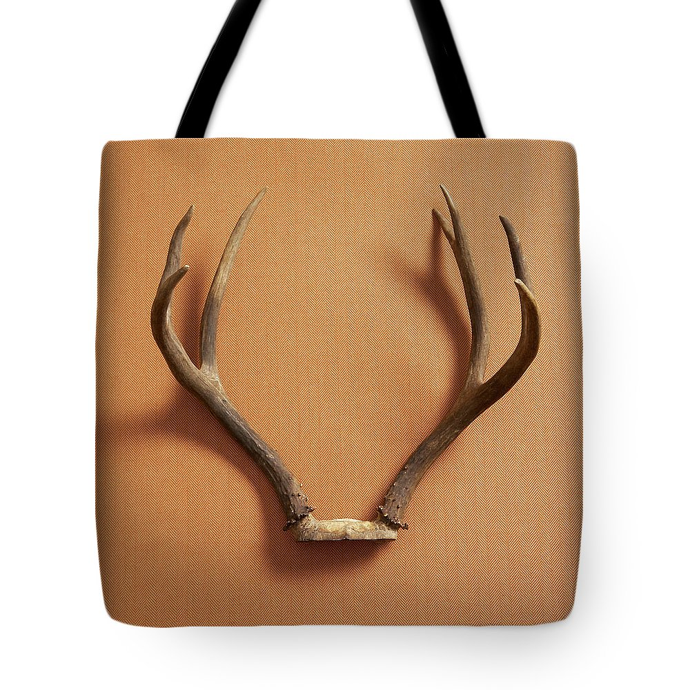 Material Tote Bag featuring the photograph Still Life Of Deer Antlers On A Fabric by Gwen Rodgers