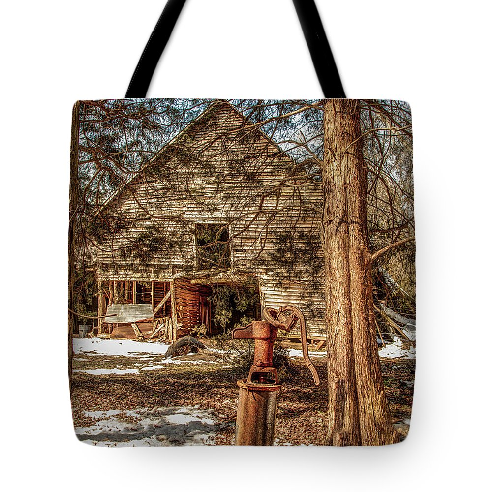 Clouds Tote Bag featuring the photograph Still Standing by Bobby Hicks