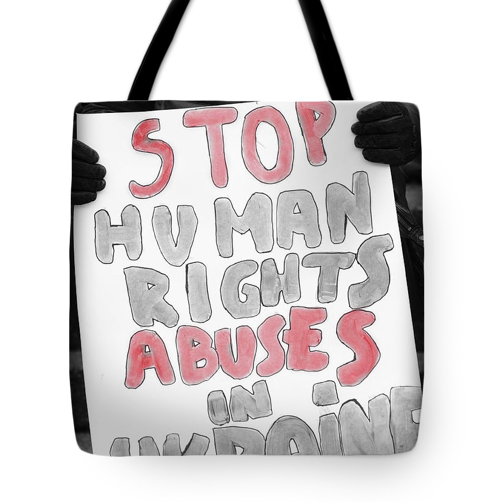 Street Photography Tote Bag featuring the photograph Stop Abuses by The Artist Project
